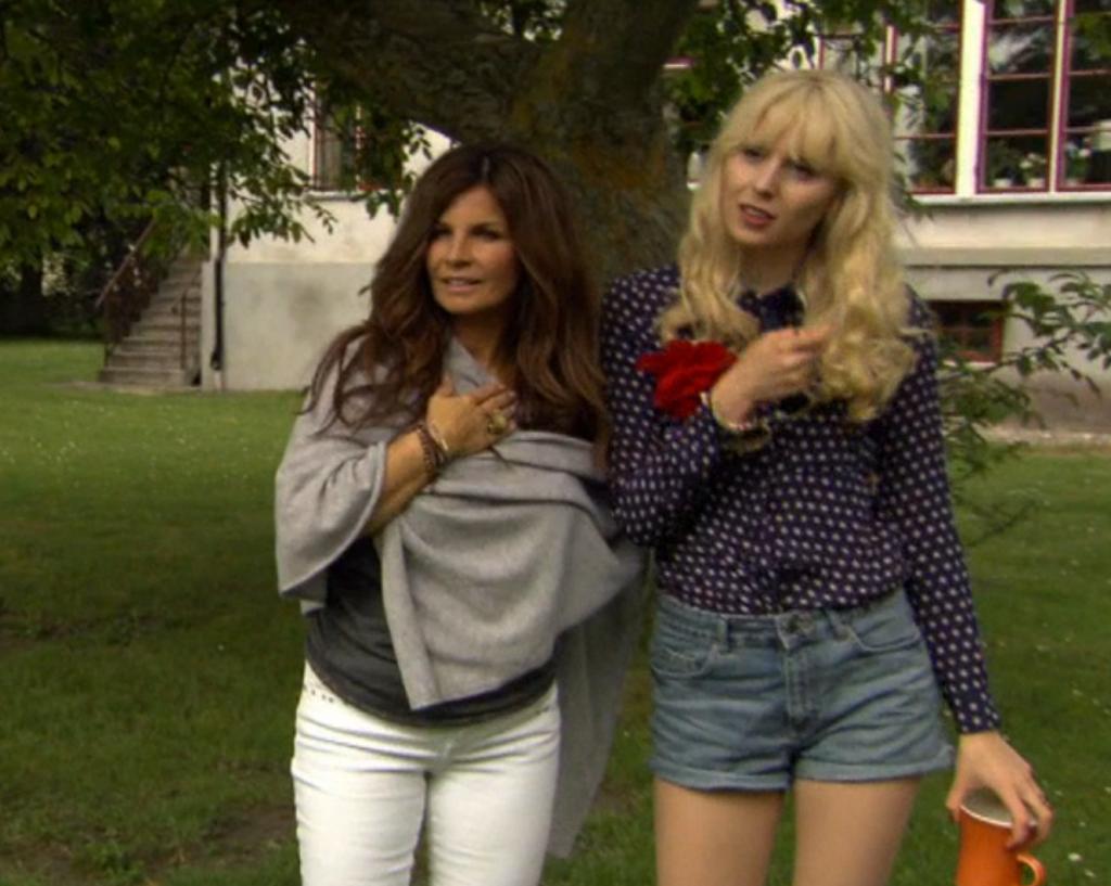 Carola wearing poncho by MODES STOCKHOLM